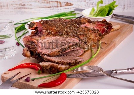 Slow Roasted Leg of Lamb. Herb Crusted Leg of Lamb. Roast Lamb with Rosemary and Garlic.  - stock photo