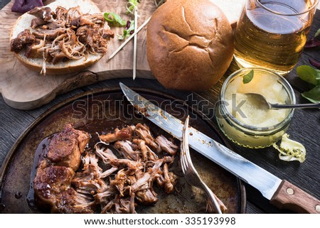 Slow roasted pulled pork sandwich with cider - stock photo