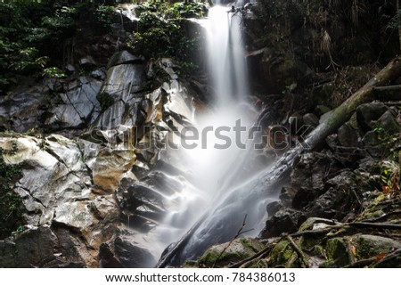 Slow shutter image of waterfall creating a smooth silky flow