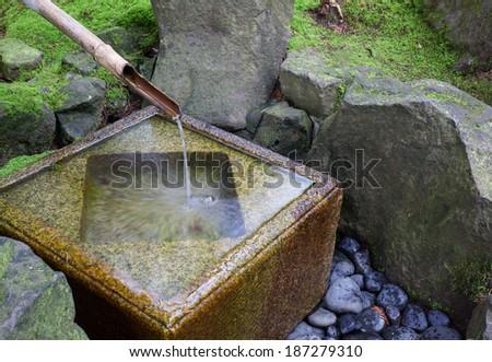 Slow shutter shot of Japanese water fountain - stock photo