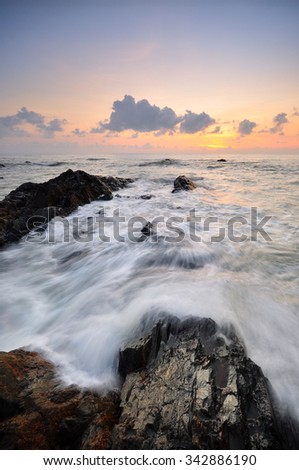 Slow shutter speed shot of seascape during sunrise. Soft focus due to slow shutter speed shot. Vibrant colors. Nature composition.