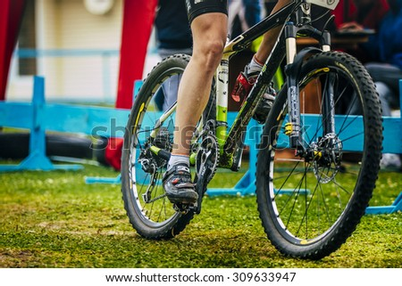 Sludorudnik, Russia - August 06, 2015:  young men mountain bike during Spartakiada among boys and girls in Cycling-mountain bike, Sludorudnik, Russia - August 06, 2015