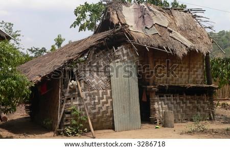 Slum house of the M'nong in Vietnam - stock photo