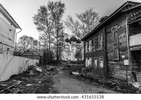 slum yard with a white church on a background contrast