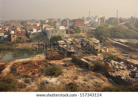 Slums of New Delhi seen from Tughlaqabad Fort, India - stock photo