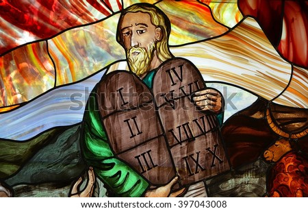 SLUPSK, POLAND - 27 MARCH 2016 - stained glass window depicting Moses with the Ten Commandments - stock photo