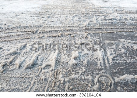 Slush and snow with tyre marks and footprints