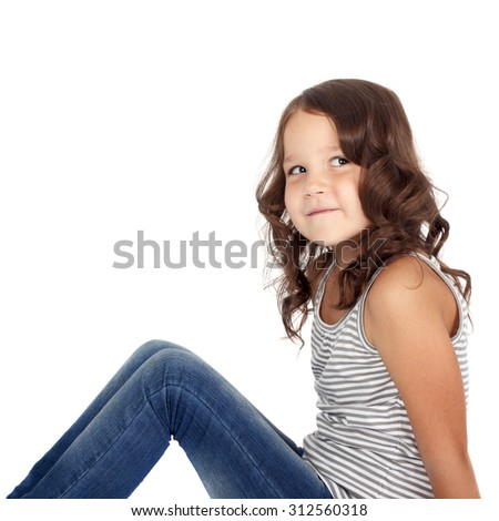 sly little girl sitting on the floor and looking up