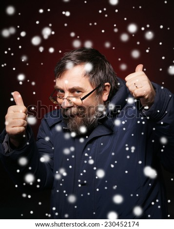 Sly old man in glasses showing yes. Christmas and holidays concept