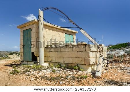 Small abandoned brick built hut  - stock photo