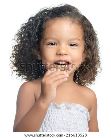 Small afro american girl eating a chocolate cookie isolated on white - stock photo