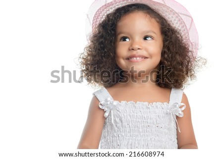 Small afro american girl with curly hair wearing a pink hat and smiling  isolated on white