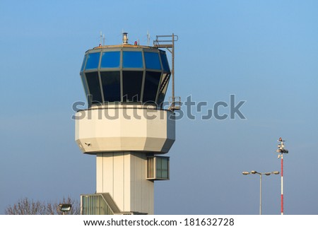 Small air traffic control tower in the morning on a nice day. - stock photo