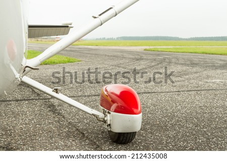 Small airplane chassis on a taxiway - stock photo
