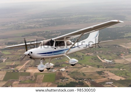 Small airplane flying - stock photo