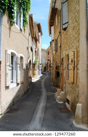 Small alley and stone houses, Lourmarin village, Vaucluse, Provence, France - stock photo