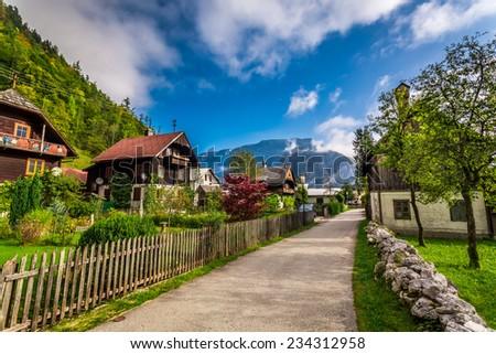 Small alley in the alpine village - stock photo