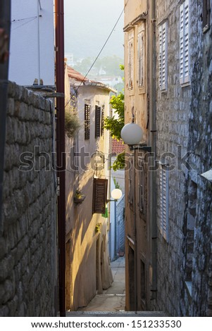 Small alley in the old city Rab, in Croatia