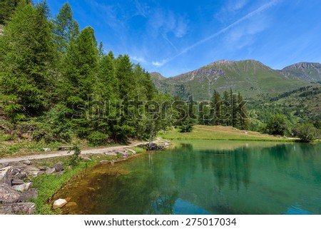 Small alpine lake Laux in the mountains of Piedmont, Northern Italy. - stock photo