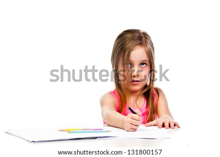 Small and beautiful girl draws pencil