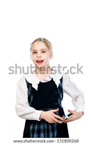 Small and beautiful girl playing psp - stock photo