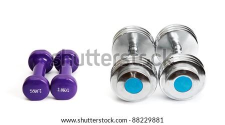 Small and big dumb-bells - stock photo