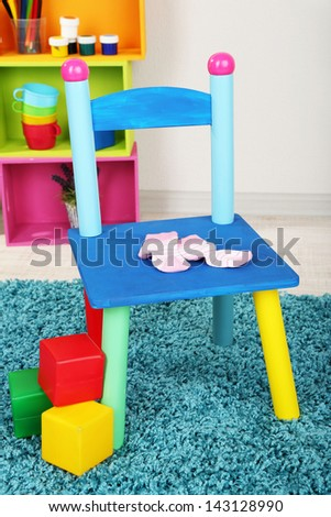 Small and colorful chair for little kids - stock photo