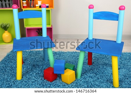 Small and colorful chairs for little kids - stock photo