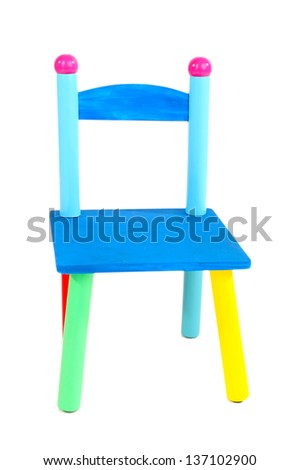 Small and colorful chairs for little kids isolated on white - stock photo