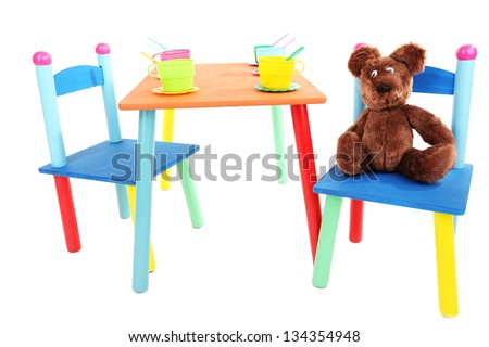 Small and colorful table and chairs for little kids isolated on white - stock photo