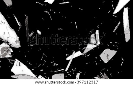 Small and large pieces of shattered black glass isolated on black