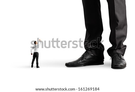 small angry businessman looking up and showing fist to his big boss. isolated on white background - stock photo