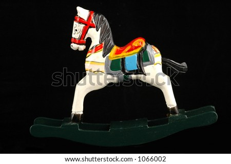 Small antique rocking horse. - stock photo