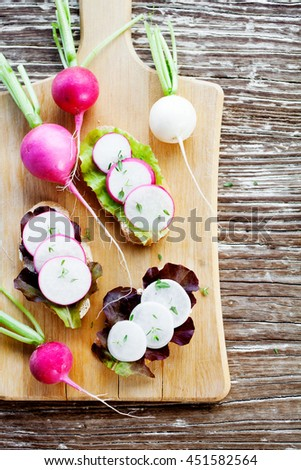 Small appetizer bruchetta with radish - stock photo