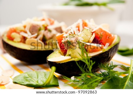 Small Appetizer Sized Paleo Salads Served in Halved Avocados - stock photo