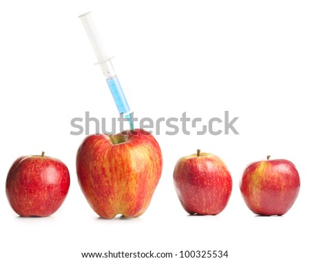 small apples and a big one with syringe