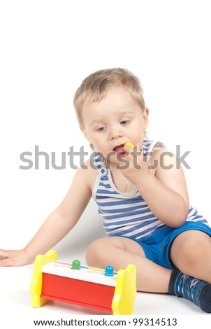 Small baby boy with a toy isolated on white