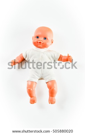 small baby doll with blue eyes on white background