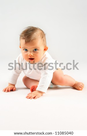 small baby girl sitting over white background