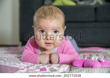 Small baby is looking to camera. She is 3 month old.  - stock photo