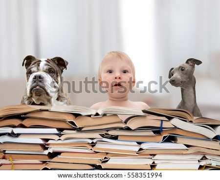 Small baby is surrounded by big stack of books