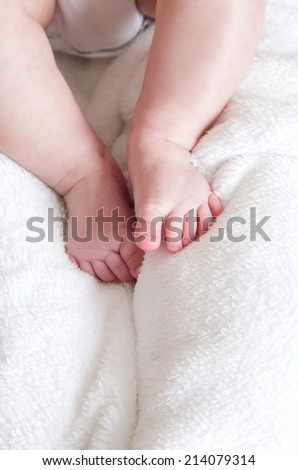 small baby legs on the bed