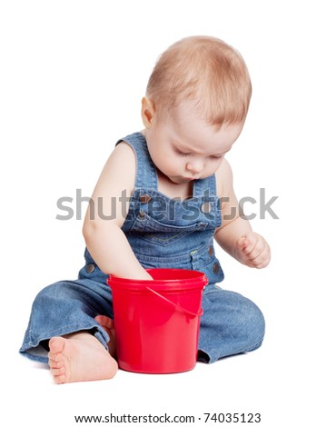 Small baby with toy bucket. Isolated on white - stock photo