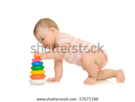 Small baby with toy pyramid