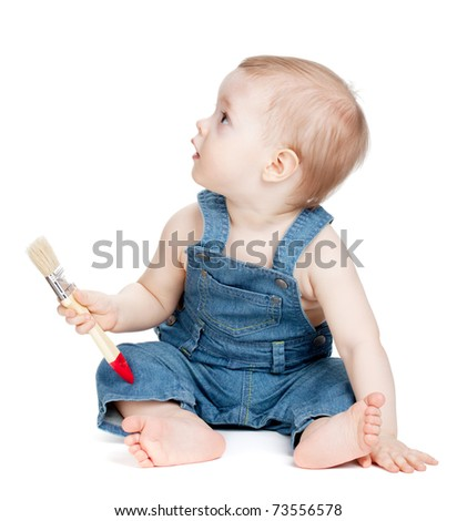 Small baby worker with paint brush. Isolated on white