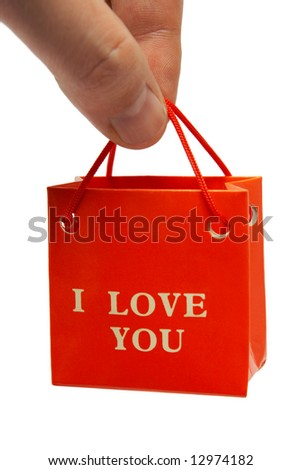 Small bag in hand, isolated on white background - stock photo