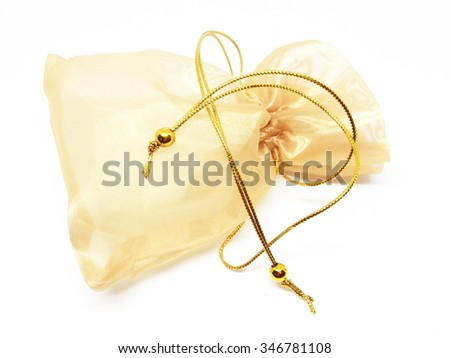 Small bag of gold on white background - stock photo