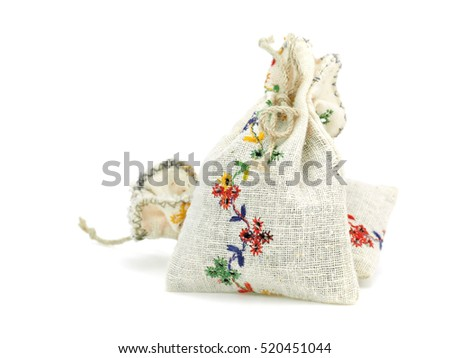 Small bags with dried lavender herb on a white background