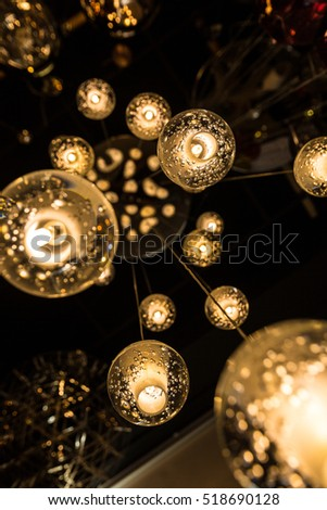 Small Balls Chandelier hanging from ceiling