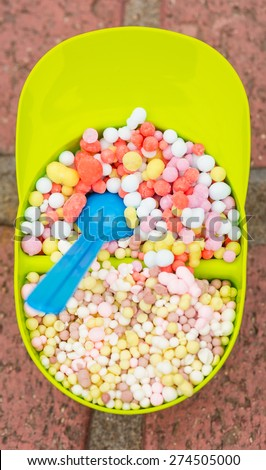 Small balls of a delicious ice-cream in a hat bowl on a brick table - stock photo